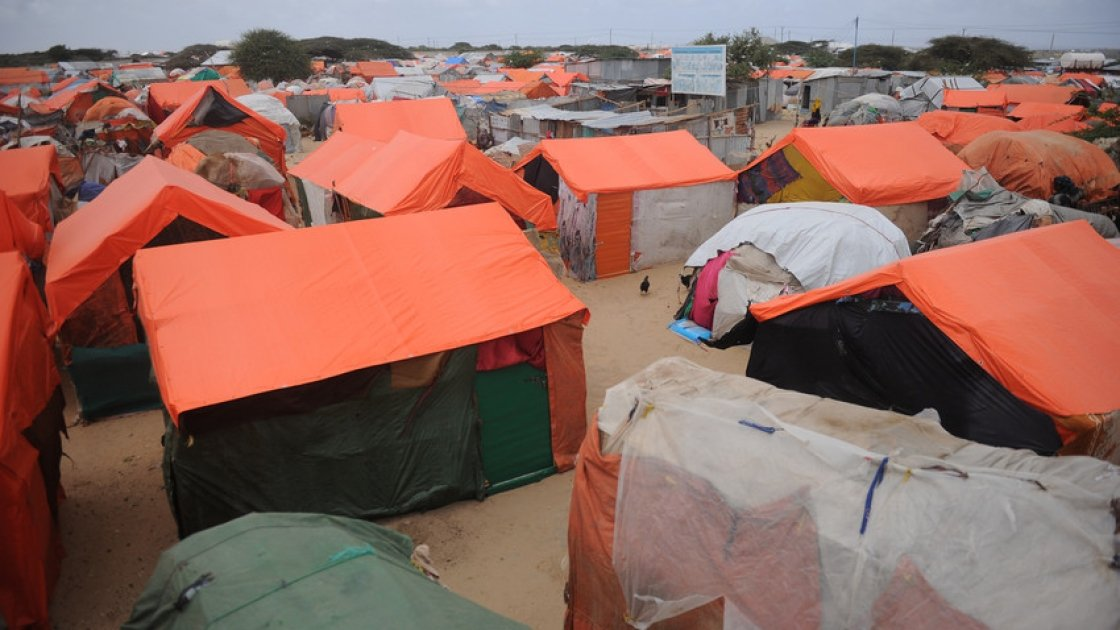 Makeshift houses in an IDP camp in Somalia. They are made up of old clothes and sacks reinforced by sticks with plastic sheets on top to avoid rains. Photo: Mohamed Abdiwahab / Concern Worldwide