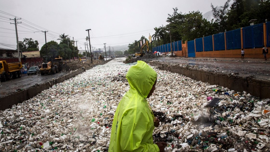 Woman pictured in littered street.