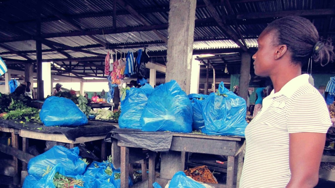 Quarantine team member Sharon visits the market on Old Road, Liberia, to collect food for families. Photo taken by Concern Worldwide.