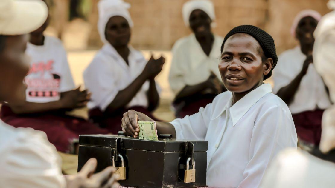 Mafulesi Matengambiri contributes her savings during a meeting of her Village Savings and Loan Group in Nsanje district. Photo taken by Chipiliro Khonje / Concern Worldwide 2014.