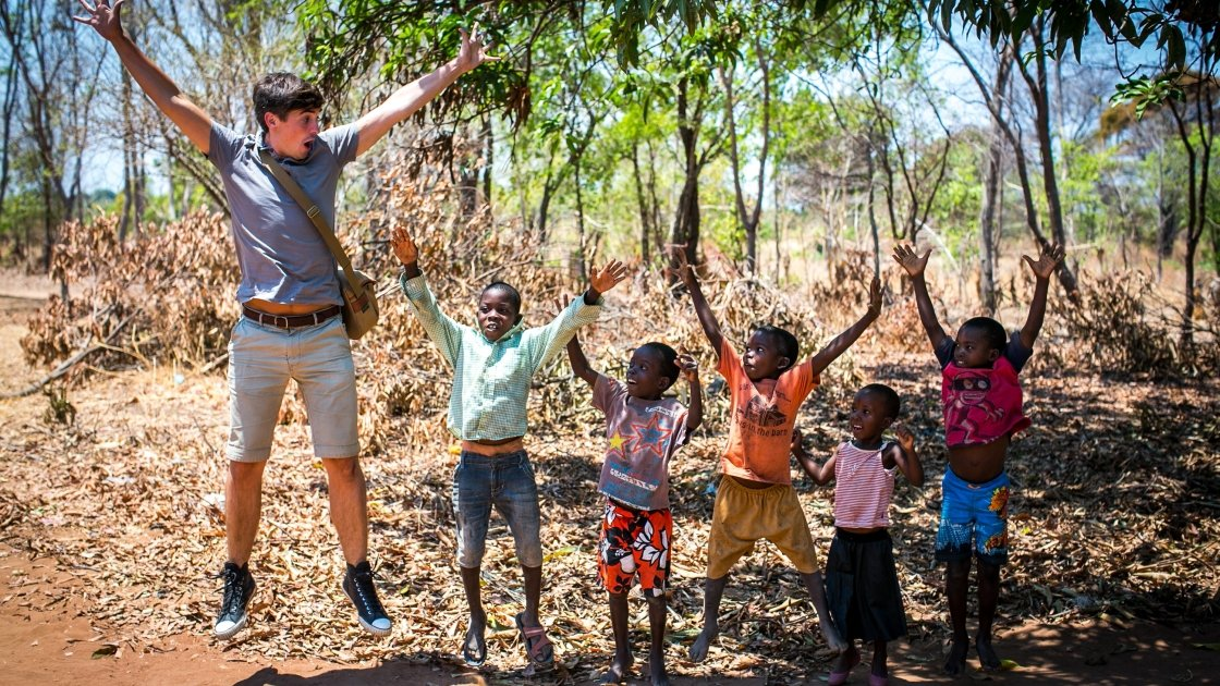 TV cook and writer Donal Skehan jumping for joy with children of Jambawe village, where Concern provided a bike ambulance. Photo: Concern Worldwide.