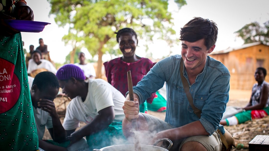 Food writer, photographer and TV presenter Donal Skehan with 'lead mothers'in Kaigwanga Village, Mchinji, Malawi. Photo: Jennifer Nolan / Concern Worldwide.