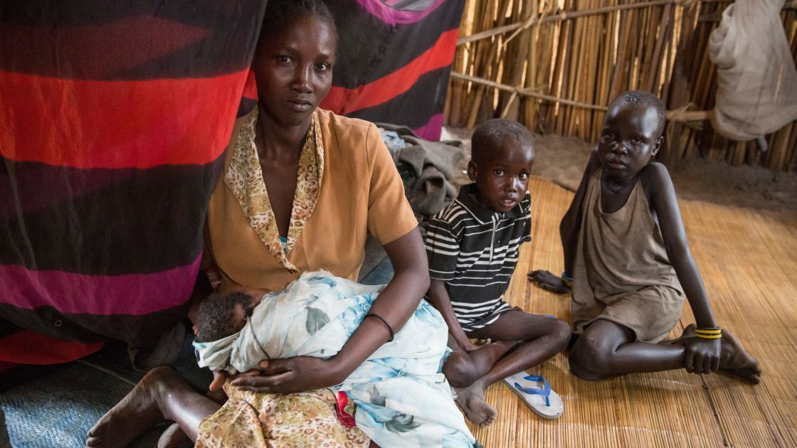 Nadia* with three of her children on the island of Touch Riak where they have sought refuge from violence. South Sudan, March 2017. Photo: Kieran McConville, Concern Worldwide.