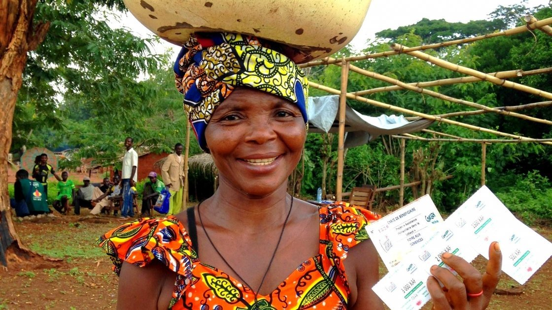 Wiligala Isabelle from Kenenge village is pictured holding her vouchers used to purchase seeds and tools at a seed fair organised by Concern. Photo: Concern Worldwide.