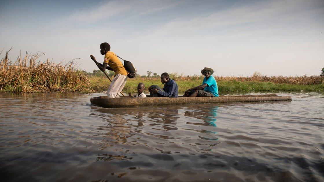 Nile Hope staff travel through the swamps by canoe. Sometimes it can take two days to reach a remote destination. Photo: Kieran McConville / Concern Worldwide