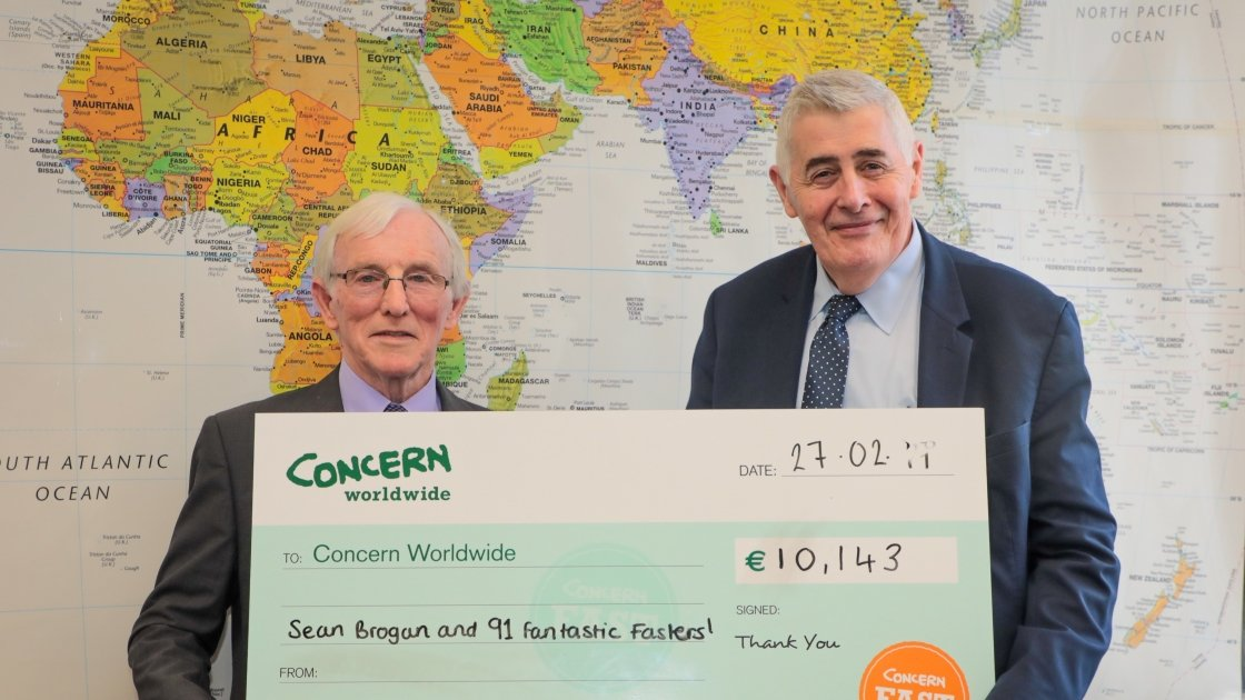 Cavan native Sean Brogan with Concern Worldwide CEO Dominic MacSorley at Concern's Dublin headquarters presenting his cheque for €10,143