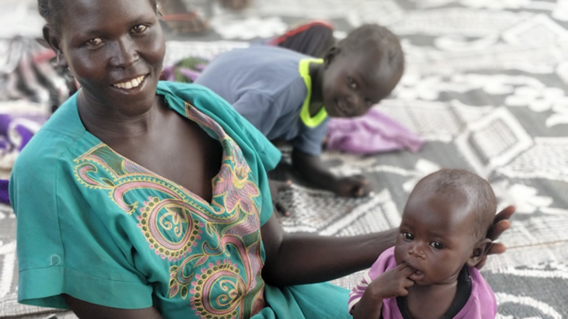Little Maria Abuk with her mother Athieng Makuac, while attending their second check-up at Concern's OTP site in Aweil North, South Sudan