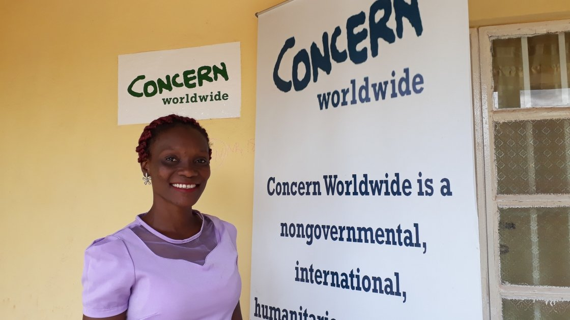 Mabrat Abdulai, Learning and Knowledge Management outside Concern's office in Tonkolili. Photo credit: Carlos Velazquez.