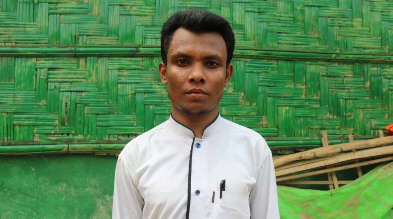 Amir* has been a refugee in Bangladesh since 2017. Now we works as a volunteer for Concern, screening young children for malnutrition. Photo:  Sabrina Idris / Concern Worldwide.