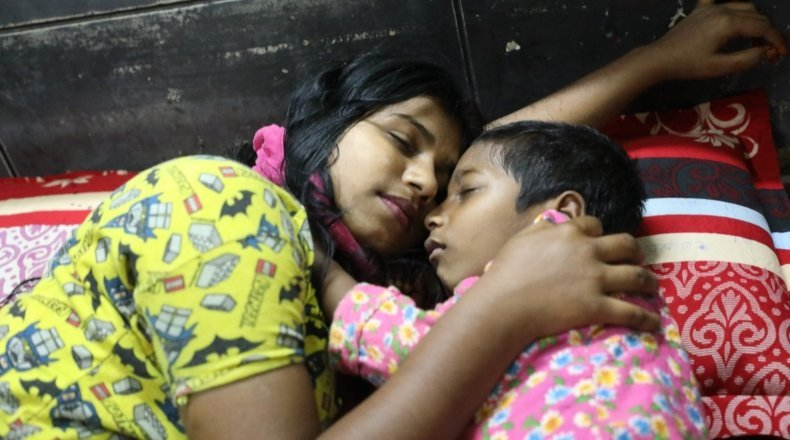 Sadia* (15) and her brother Mahir* sleep safely in a Concern supported Pavement Dweller Centre (PDC)