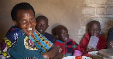 Violette Bukeyeneza sitting with her family in Cibitoke, Burundi. Photo: Abbie Trayler-Smith / Concern Worldwide.