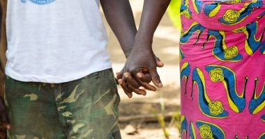 Hands holding. Photo: Gavin Douglas / Concern Worldwide.