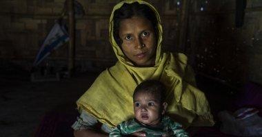 Married mum of six Reshma* (30) with adopted niece Tahira* (9 months) Rohingya Refugee Crisis, Bazar Camp, Bangladesh Photo: Abir Abdullah / Concern Worldwide