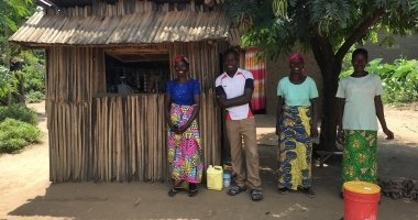 Graduation beneficiaries in front of the shop they have set up under the project; they have taken the initiative to establish a hand-washing station in front of the shop and they report soap sales have increased in the last few days as communities have been sensitised on the importance of hand-washing to prevent COVID transmission. Burundi Photo: Maud Biton / Concern Worldwide