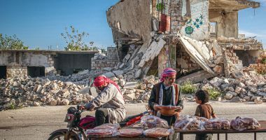 Inhabitants of Idlib, Syria, with pide, a traditional round and flat bread, during the holy month of Ramadan. Anadolu Agency via AFP/Muhammed Said 2021