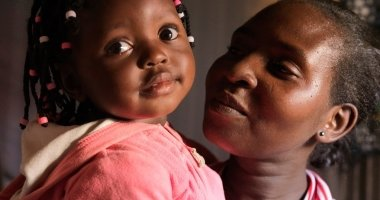 Mum-of-three Scholastica Mbinya  with her youngest child, 17-month-old Francisca. Photo: Peter Caton / Concern Worldwide.