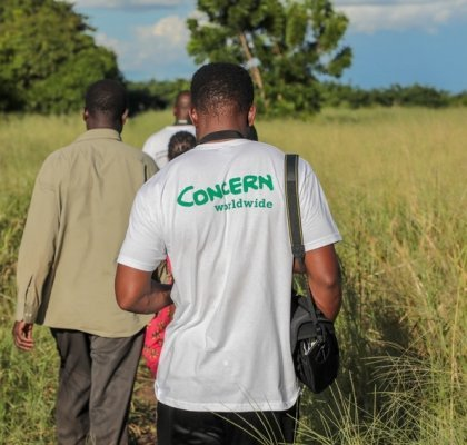 Concern team member, Sam, takes a camera to document the damage to crops in Nsendje, Malawi. Photo: Gavin Douglas/Concern Worldwide.