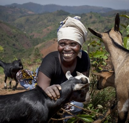Meresiyana Cimpaye (40) with the goats she bought from the profits of her Graduation Programme cash transfer. Photo: Abbie Trayler-Smith / Concern Worldwide.