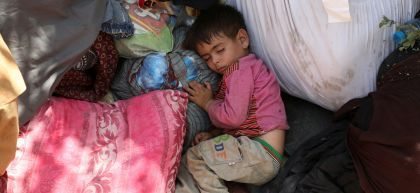 An internally displaced child sleeps in a public park in Kabul, Afghanistan.