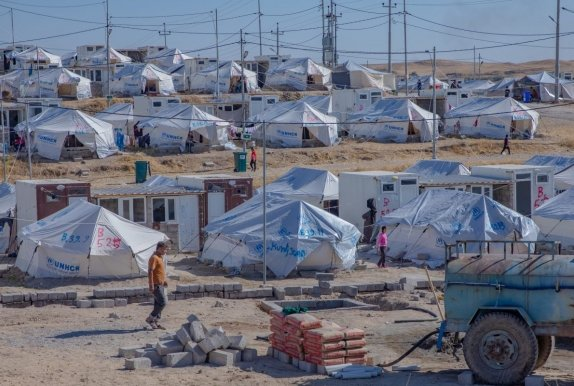 A refugee camp in north-west Iraq. 11,000 people have fled from Syria to this camp with an estimated 500 more people crossing the border per day.  Photo: Gavin Douglas