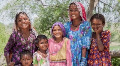 Smiling sisters from Hiklyo Village. Photo: Black Box Sounds/Concern Worldwide.