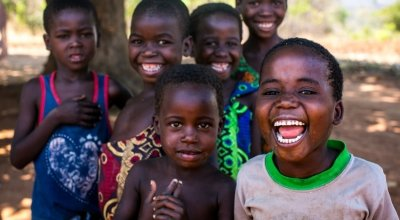 Children in Malawi gather and smile for the camera. Photo: Jennifer Nolan / Concern Worldwide.