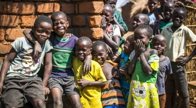 Children outside John Yamikani's family home in Malawi. Photo: Donal Skehan/Concern Worldwide.