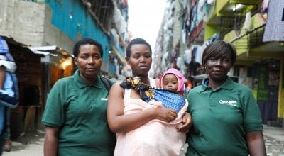 Jacqueline and her daughter Faith pictured with two Concern workers. Photo: Jennifer Nolan / Concern Worldwide.