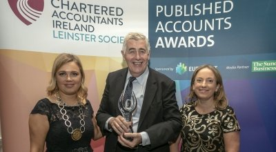 Concern CEO Dominic MacSorley with one of our many awards for our annual reports. Photo: Concern Worldwide