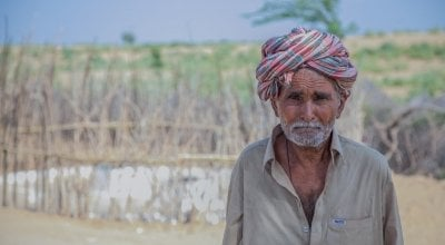 Ghulam Muhammad from Nasirani village, Umerkot, Pakistan stands outside his house. Photo: Black Box Sounds.