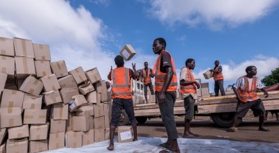 A team of locally hired workers unload a truck carrying supplies in Ndeja, Mozambique. Photo: Tommy Trenchard / Concern Worldwide.