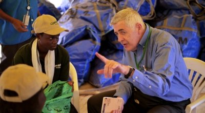 Concern Worldwide CEO Dominic MacSorley with Victoria Gune at a relief distribution in Juba, South Sudan. Photo: Concern Worldwide.