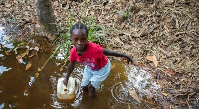 Darling Girl collecting water from the Toe Town creak. During the dry season, this creak is reduced to a couple of inches of murky water. Photo: Gavin Douglas/Concern Worldwide.