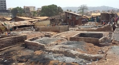 The remains of a slum on Sierra Leone following a fire.