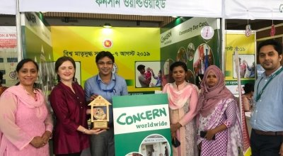 Concern's Bangladesh team hold the award at an event organised as part of observing Breast Feeding Week. Photo: Hasina Rahman / Concern Worldwide