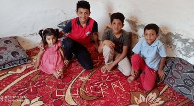 Samer* (14) with his sister Amira* and brothers Nahed* and Zeyn*. *Names changed to protect the identity of individuals. Photo: Concern Worldwide.