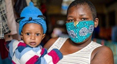 Jane Wanjiru has brought her baby son Mark Moses to Mukuru Health Centre, where staff members will take his weight, MUAC and other measurements. Photo: Ed Ram / Concern Worldwide