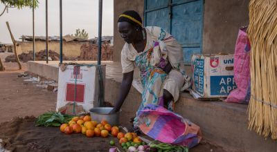 A woman pictured with fresh fruit and vegetables.