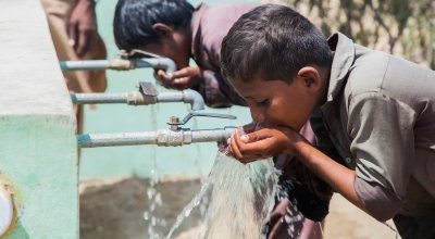 Young boys enjoying a drink at a newly installed water system in Umerkot, Pakistan. Photo: Concern Worldwide.