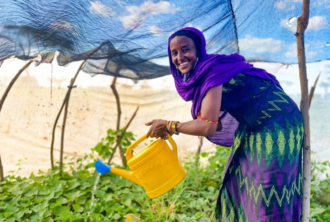 Sori waters her kitchen garden which she has managed to grow in the arid conditions of Marsabit in Kenya with the support of Concern.